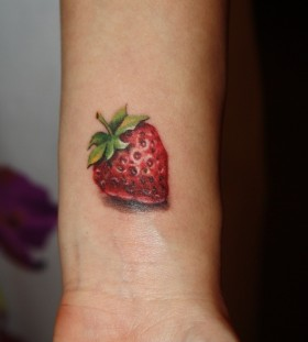 Gorgeous strawberry tattoo