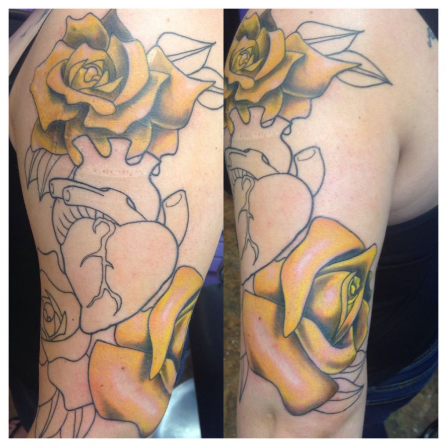 Hear realistic black and yellow rose tattoo