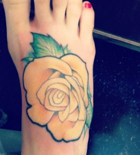Red nails and yellow rose tattoo
