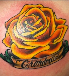 Simple quote and yellow rose tattoo