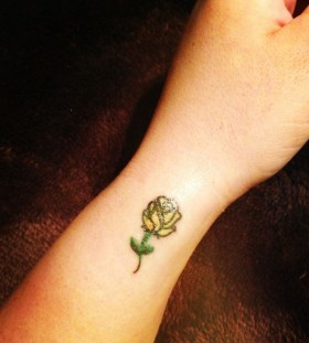 Small arm's yellow rose tatoo