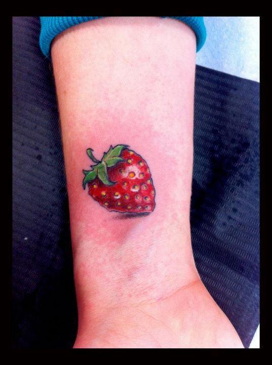 Strwberry tattoo on wrist