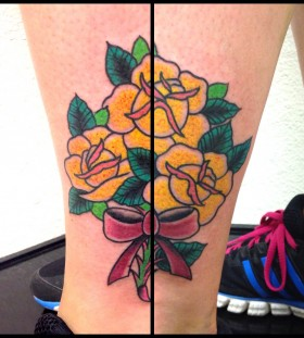 Women's trainers and yellow rose tattoo