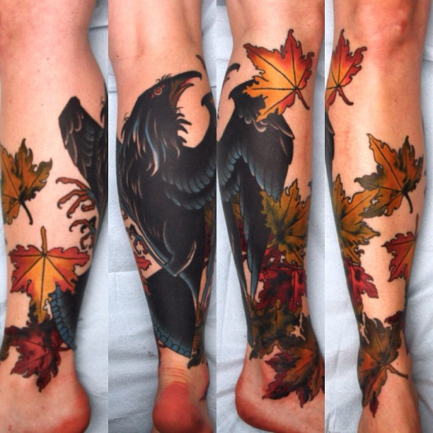leaves tattoo with black bird
