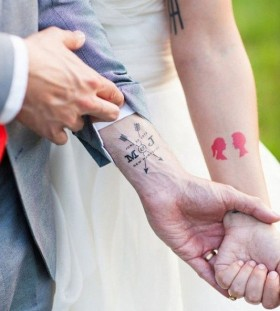 Couple wedding day and arrow tattoo
