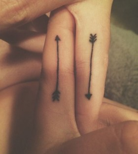 Small fingers arrow tattoo
