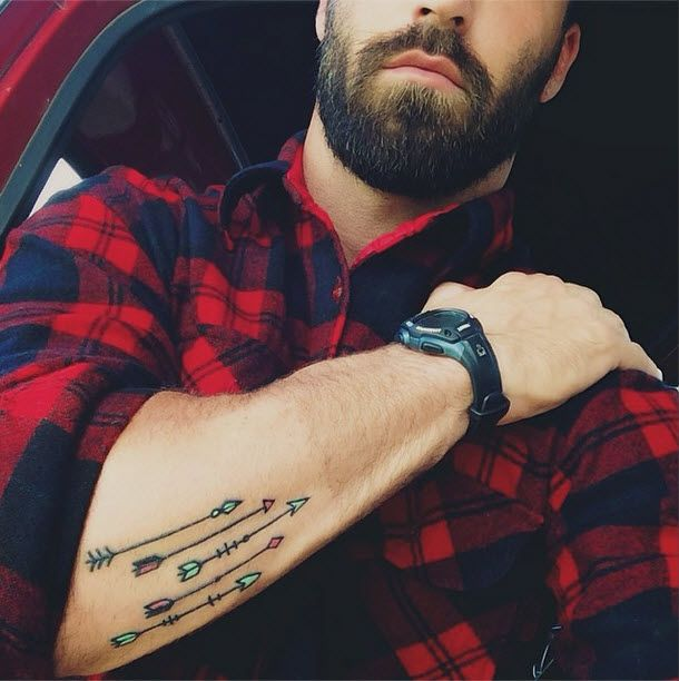Strong men's arms' arrow tattoo