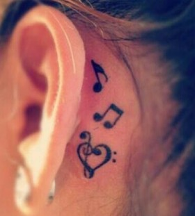 Heart and ear music note tattoo