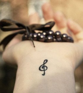 Impossibly small music note tattoo