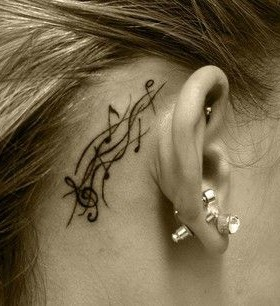 Pretty impossible music note tattoo