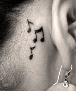 Small ear music note tattoo