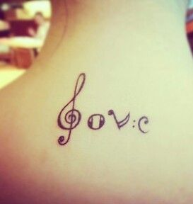 Wonderful girl's music note tattoo