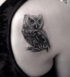 Black owl minimalistic style tattoo