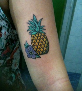 Pineapple tattoo on arm