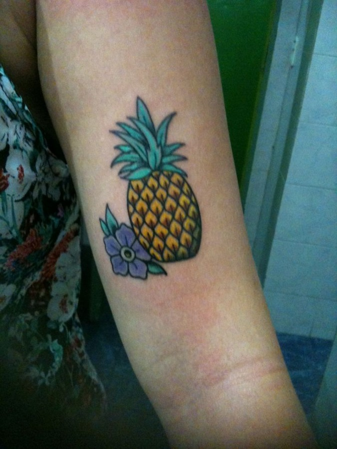 Pineapple tattoo on arm