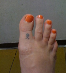 Pineapple tattoo on foot finger