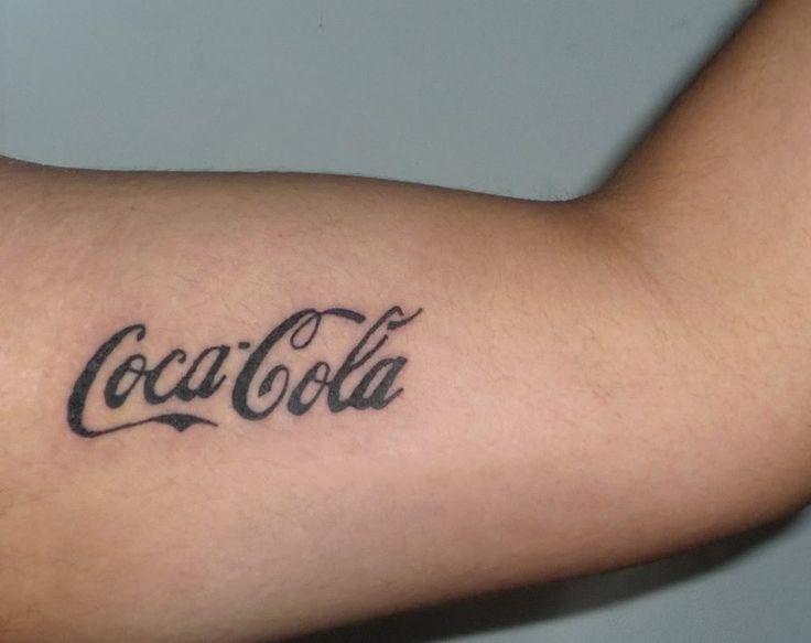 Black letters coca cola tattoo