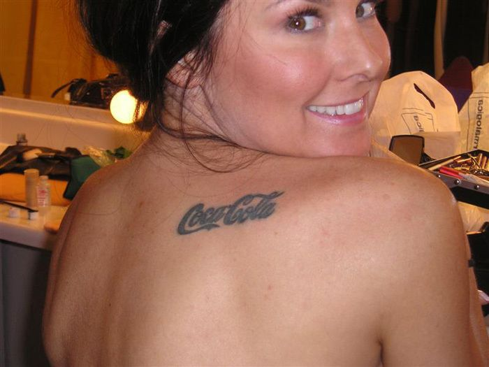 Black smiling girl's and coca cola tattoo