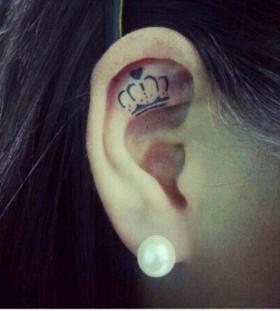 Ear black keep calm tattoo
