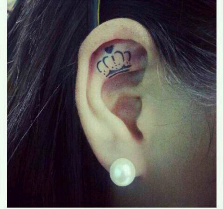 Ear black keep calm tattoo