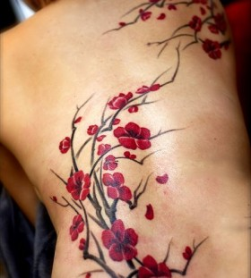 Blossom style floral tattoo