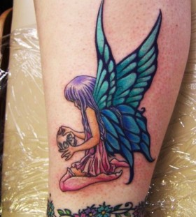 Blue adorable wing tattoo on leg