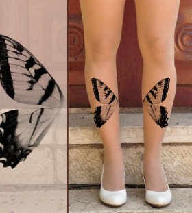 Gorgeous butterfly wing tattoo on leg