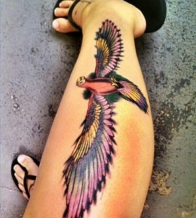 Purple lovely wing tattoo on leg