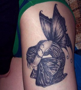Sad girl and wing tattoo on leg
