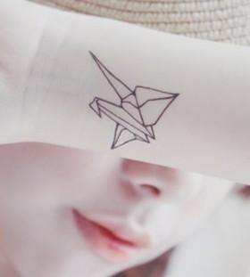 Origami bird minimalistic style tattoo
