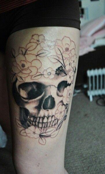 Black skull cornflower tattoo