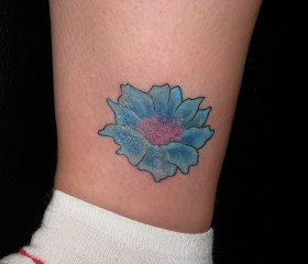 Small leg cornflower tattoo