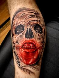 Alan Barbosa red skull tattoo