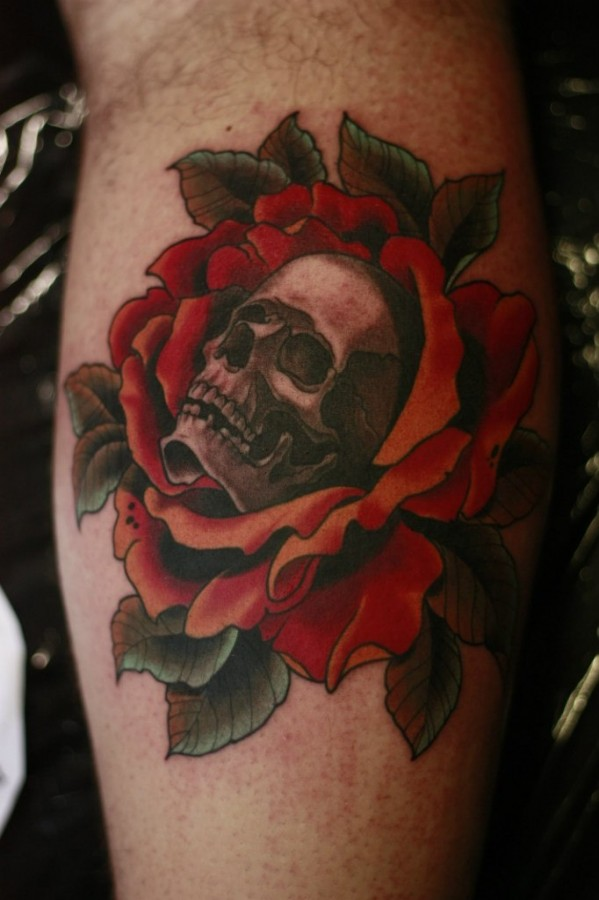 Flowers and black red skull tattoo