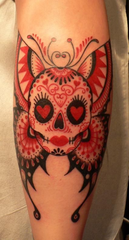 Heart and butterfly red skull tattoo