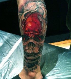 Men's leg red skull tattoo