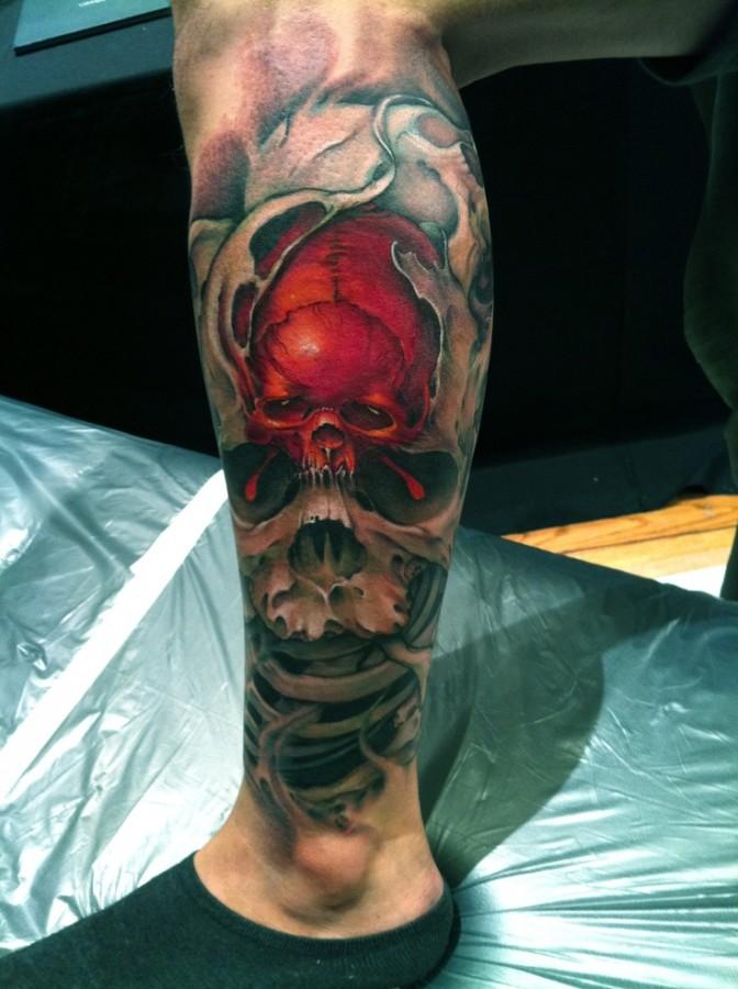 Men's leg red skull tattoo