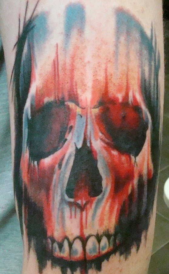 Scary blue and red skull tattoo