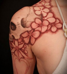 Shoulder flowers red skull tattoo