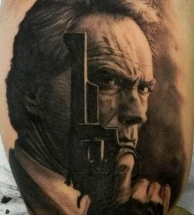 Serious men's and gun famous people tattoo