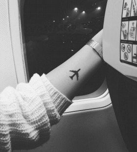 Airplane tattoo on hand
