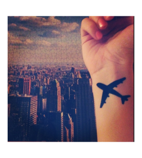 Airplane tattoo on wrist