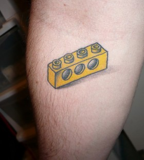 Awesome lego brick tattoo on arm