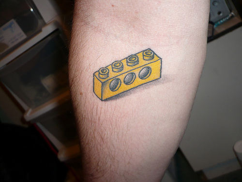 Awesome lego brick tattoo on arm