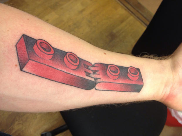 Big lego brick arm tattoo