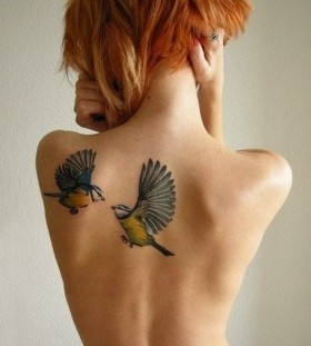 Bird's and orange hair girl's nature tattoos