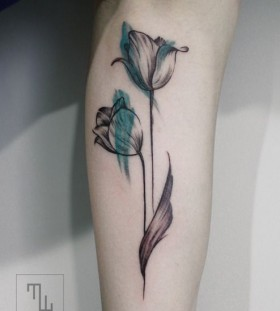 Black and blue tulip tattoo