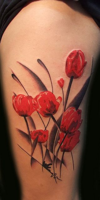 Black and red tulip tattoo