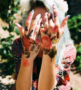 Blonde girl's nature tattoos