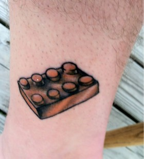 Brown lego brick tattoo